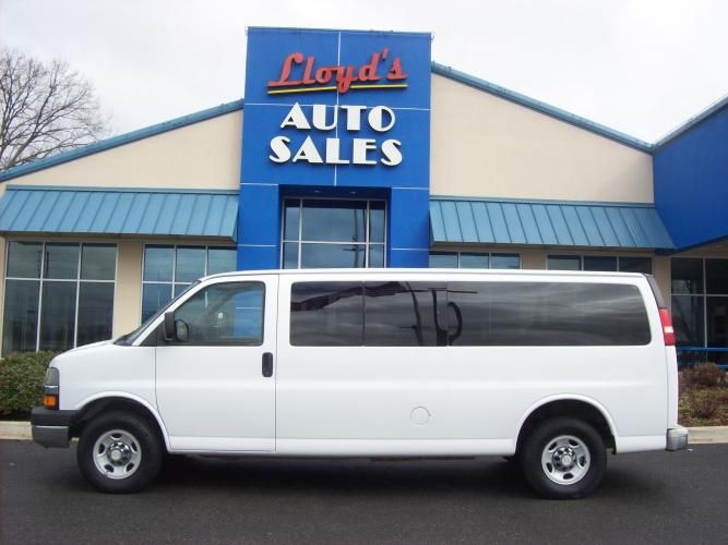 2007 WHITE /Gray / Cloth Chevrolet Express LS 3500 Extended (1GAHG39U971) with an 6.0L V8 OHV 16V engine, 4-Speed Automatic Overdrive transmission, located at 1814 Albert Pike Road, Hot Springs, AR, 71913, (501) 623-1717, 34.494591, -93.094971 - Photo #0