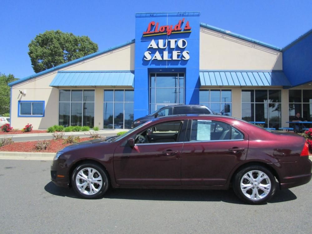 2012 MAROON /Gray/Cloth Ford Fusion SE (3FAHP0HA1CR) with an 2.5L L4 DOHC 16V engine, located at 1814 Albert Pike Road, Hot Springs, AR, 71913, (501) 623-1717, 34.494591, -93.094971 - Photo #0