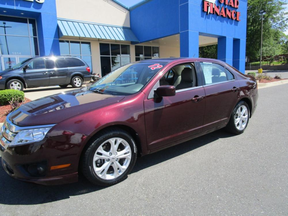2012 MAROON /Gray/Cloth Ford Fusion SE (3FAHP0HA1CR) with an 2.5L L4 DOHC 16V engine, located at 1814 Albert Pike Road, Hot Springs, AR, 71913, (501) 623-1717, 34.494591, -93.094971 - Photo #1